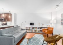 Lovely rug and bookshelf add color to the contemporary interior 217x155 Urban Aesthetics: Smart and Cheerful Modern Apartment in Vancouver