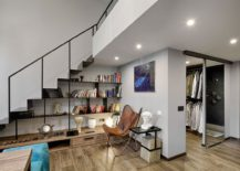 Making-use-of-space-under-the-stairs-by-turning-it-into-a-redaing-nook-with-open-bookshelves-217x155