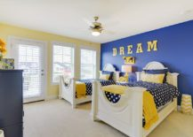 Mellow shade of yellow and bright blue create a fabulous backdrop in the smart bedroom