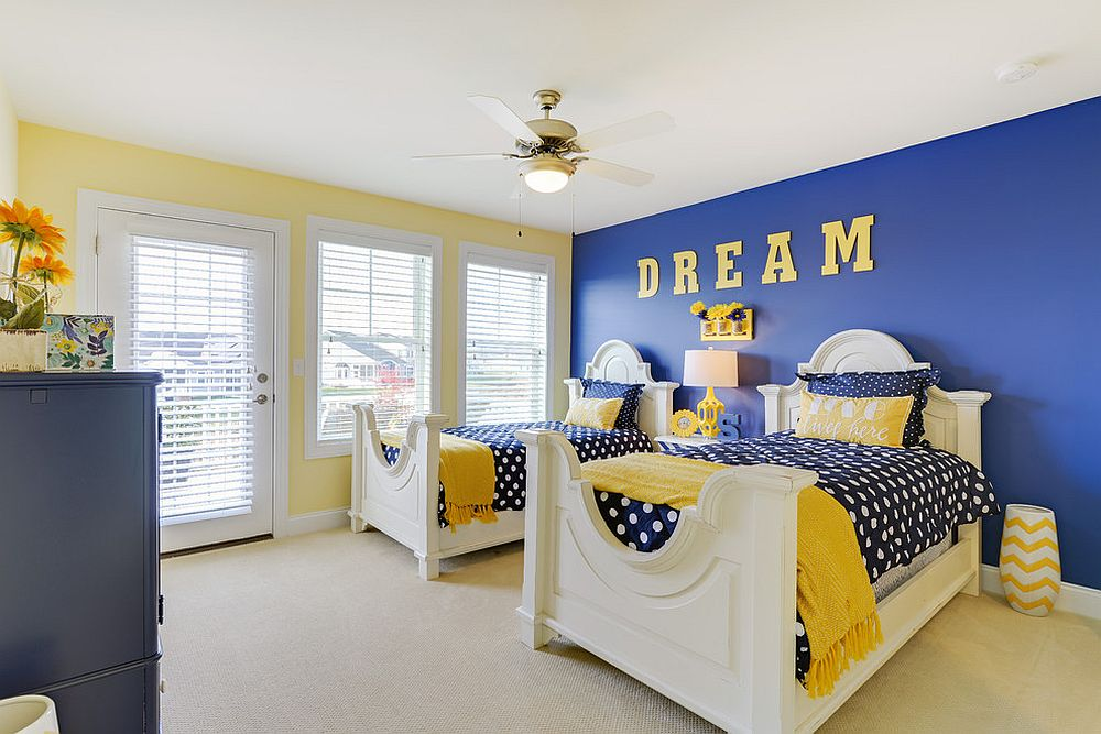 ... Mellow shade of yellow and bright blue create a fabulous backdrop in  the smart bedroom [