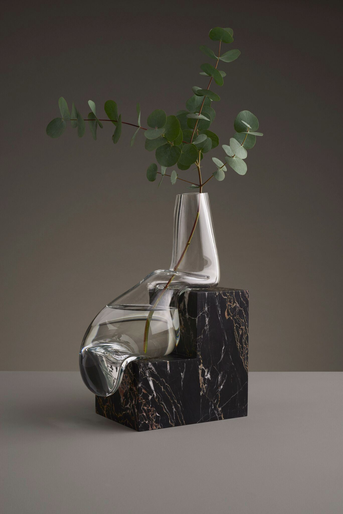 Melted vase on a black base