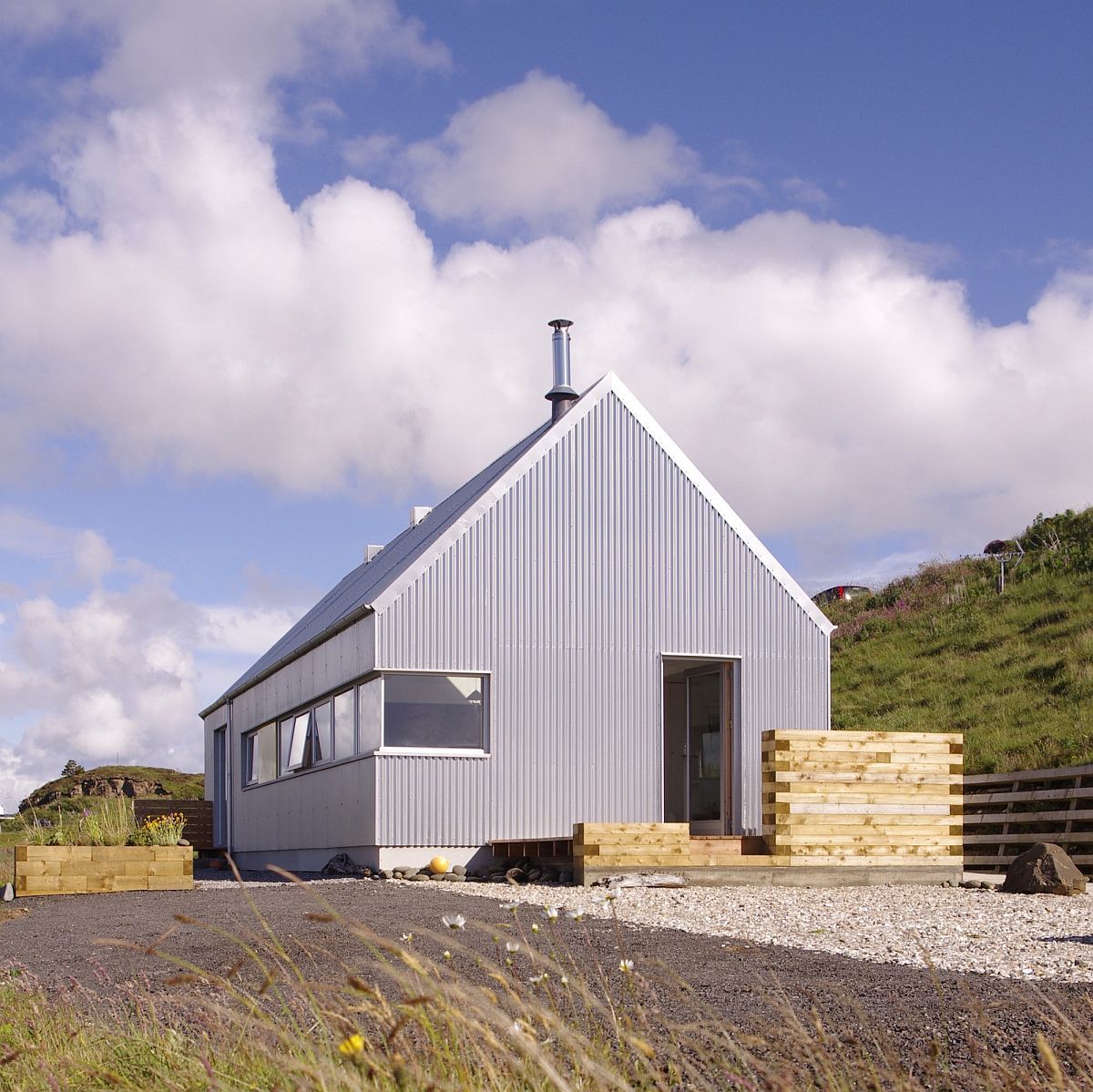 Metal and glass exterior of the Tinhouse combines farmhouse look with modern aesthetics