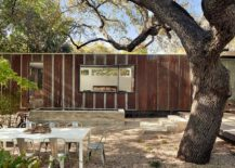 Metallic exterior of the latest extension to a breezy cottage in Austin Texas 217x155 This Texas Cottage Makes Breezy Outdoor Living Its Priority