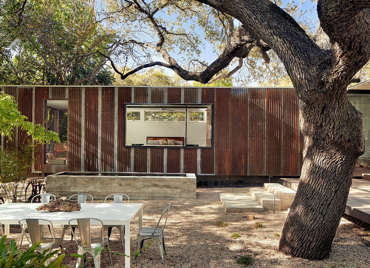 Metallic exterior of the latest extension to a breezy cottage in Austin, Texas