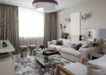 Mirrored coffee tables adds sparkle to the Scandinavian living room