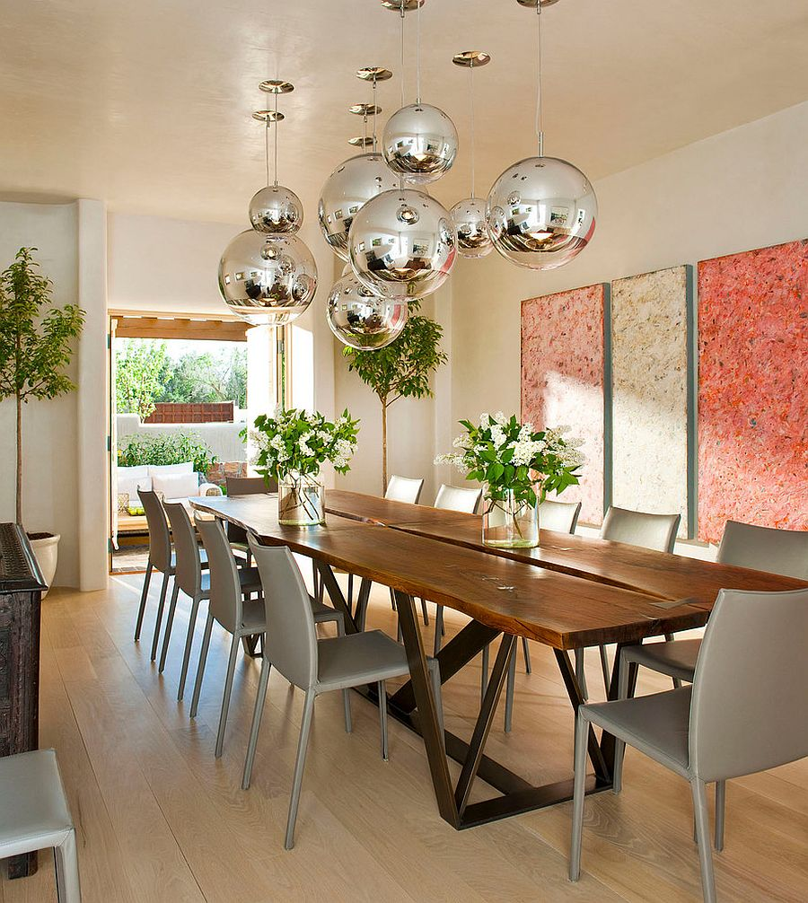 Modern Mediterranean dining room with globe metallic pendants [Design: Architectural Alliance]