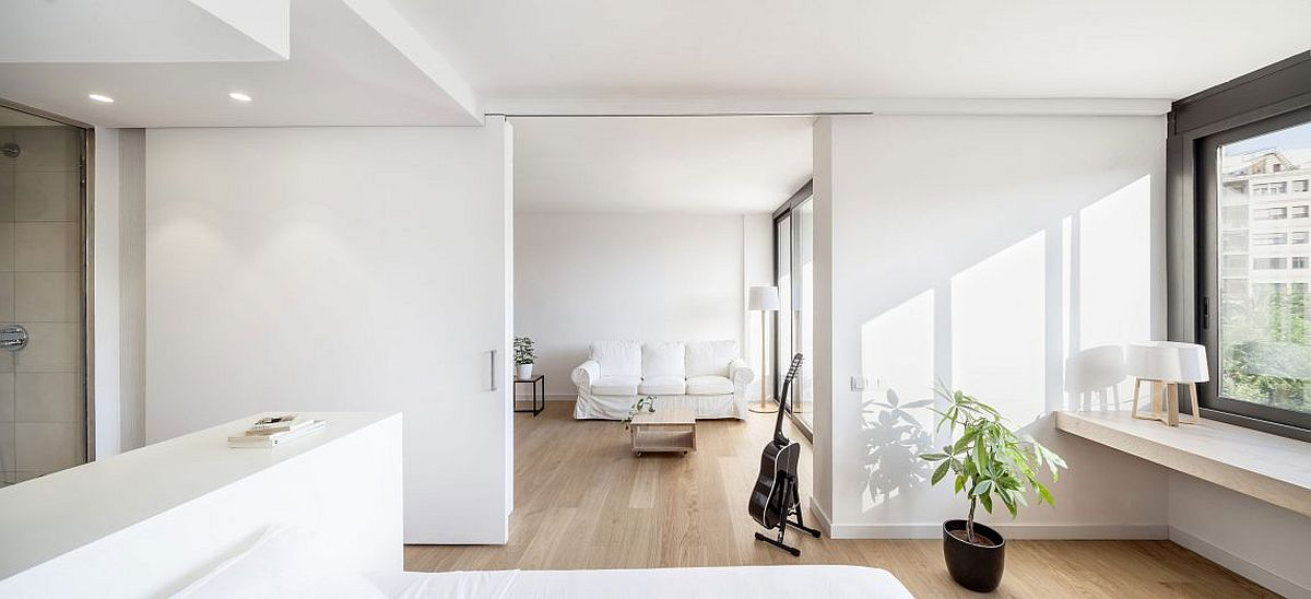 Modern apartment in white with sliding walls and doors