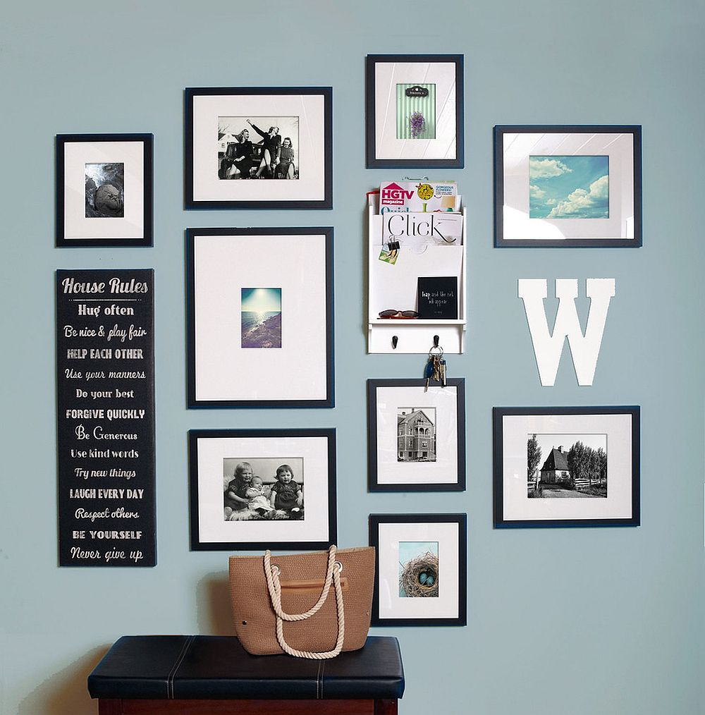 Modern art work coupled with family photographs to create a stylish gallery wall