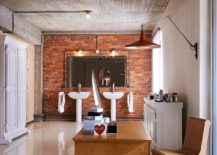 Modern bathroom with exposed brick wall