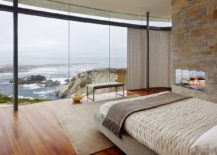 Modern-bedroom-with-a-bench-and-an-ocean-view-217x155