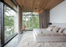 Modern-bedroom-with-a-corner-chair-217x155