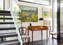 Modern entry with lovely paintings creates a stylish gallery wall