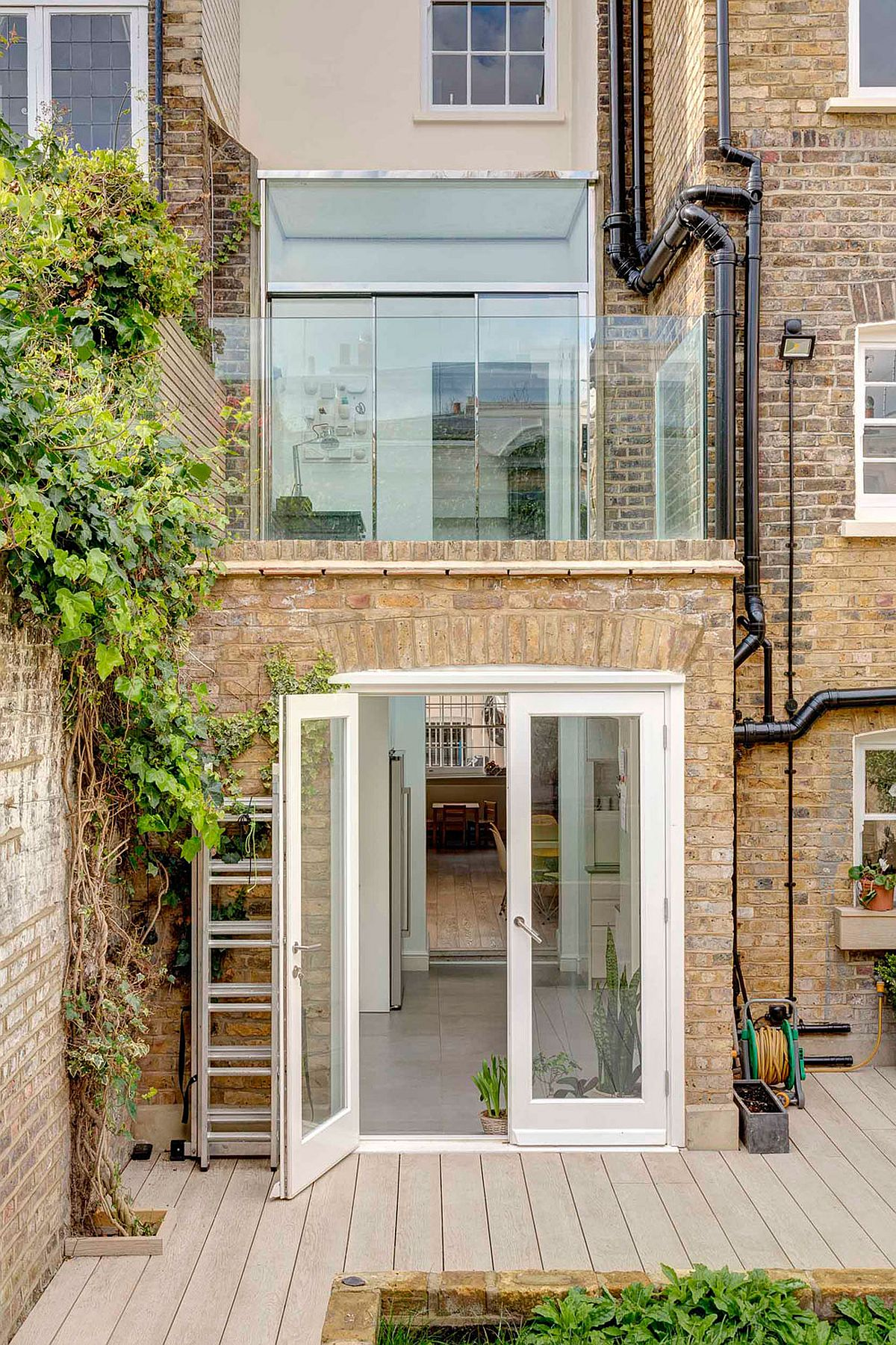 Modern extension to Grade II Listed House in Westminster Nifty Extension with Walk On Skylights Enlivens This Terrace House
