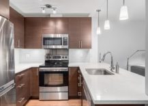 Modern kitchen featuring quartz countertops and stainless steel Samsung appliances