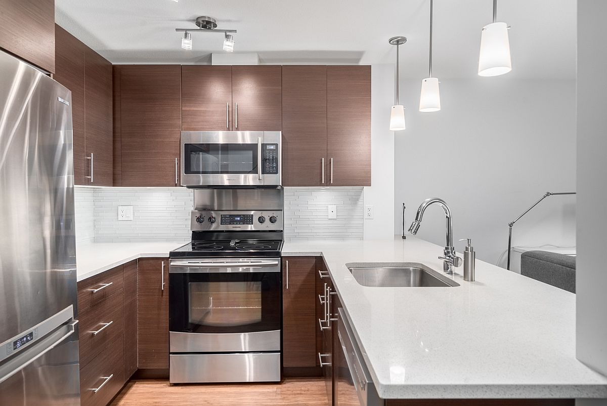 Modern kitchen featuring quartz countertops and stainless steel Samsung appliances