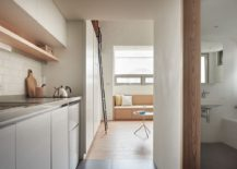 Narrow-entrance-to-the-kitchen-and-bathroom-of-the-small-urban-apartment-217x155