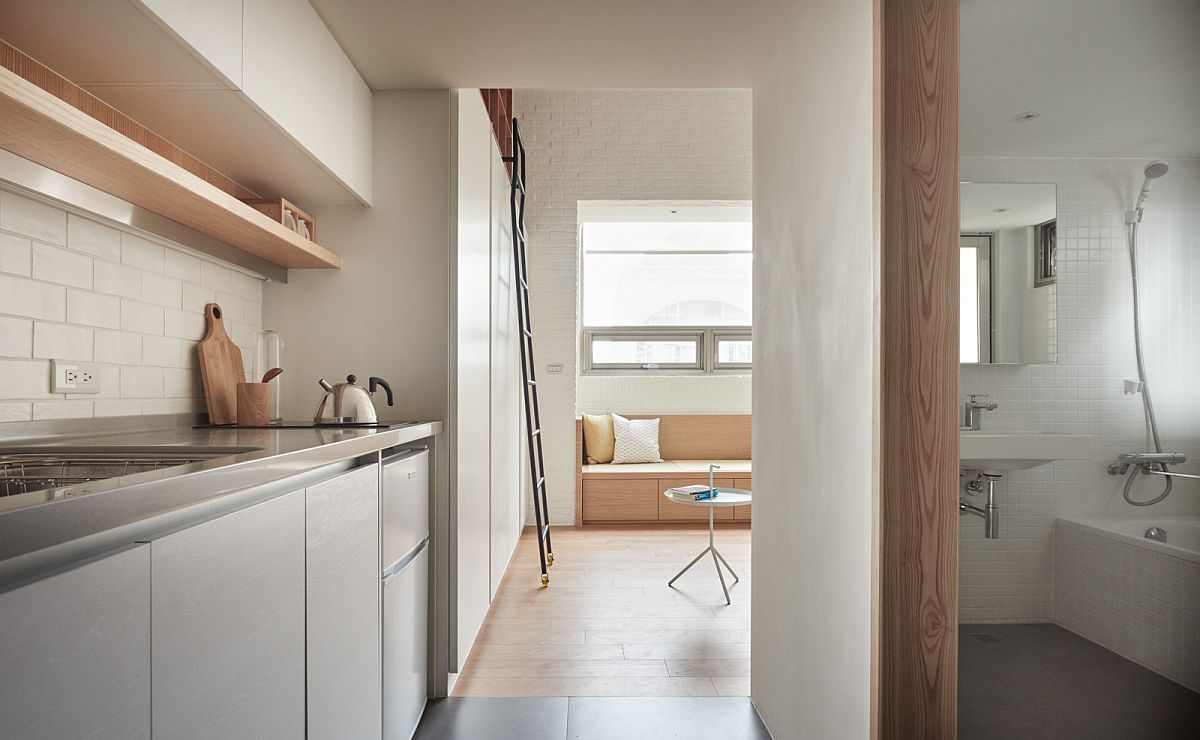 Narrow entrance to the kitchen and bathroom of the small urban apartment