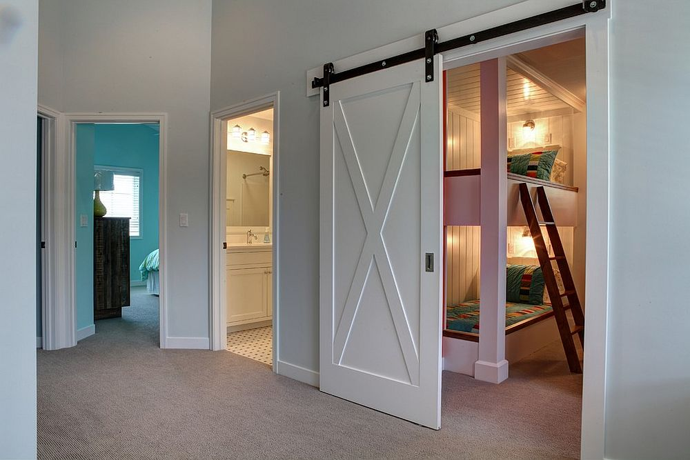 Nifty barn door is a great choice for the breezy beach style kids' bedroom [Design: Cottage Home]