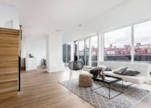 Open-living-area-of-the-Scandinavian-style-apartment-connected-to-the-lovely-balcony-outside-217x155