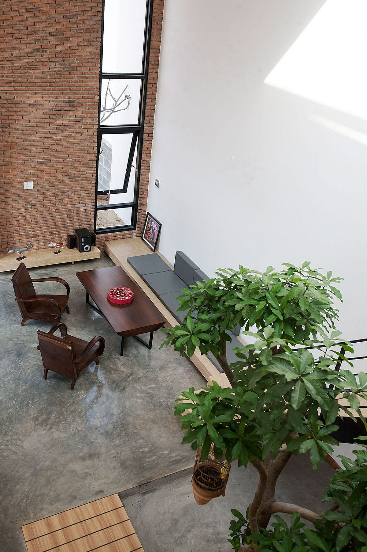 Open living space with brick wall and pleny of natural light