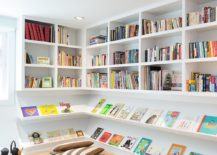 Open shelves and floor pillows give the corner a smart makeover