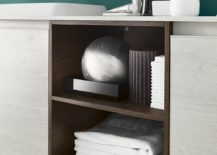 Open shelves combine with closed cabinets that feature handleless doors for the vanity