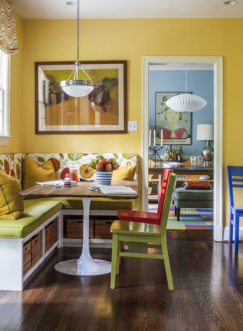 Open storage space under the bright banquette with midcentury décor [Design: Four Brothers / Christopher Patrick]