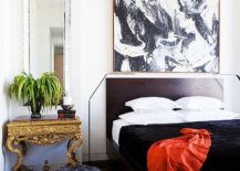 Ornate gold bedside table brings a hint of oriental charm to the contemporary bedroom