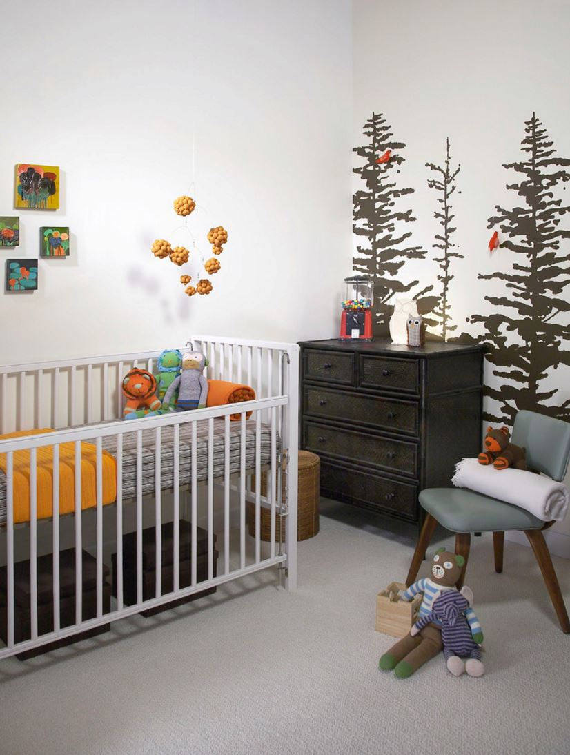 Painted tree mural in an earthy modern nursery