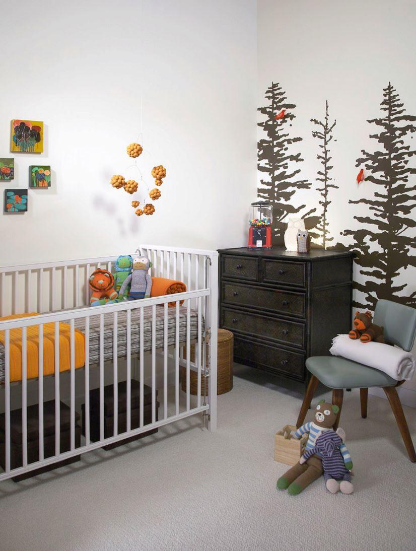 Painted tree mural in an earthy modern nursery