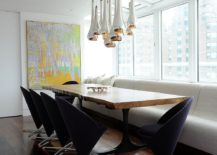 Panton cone chairs and striking metallic pendants coupled with live edge table