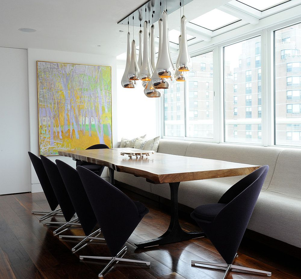 Panton cone chairs and striking metallic pendants coupled with live edge table [Design: Tori Golub Interior Design]