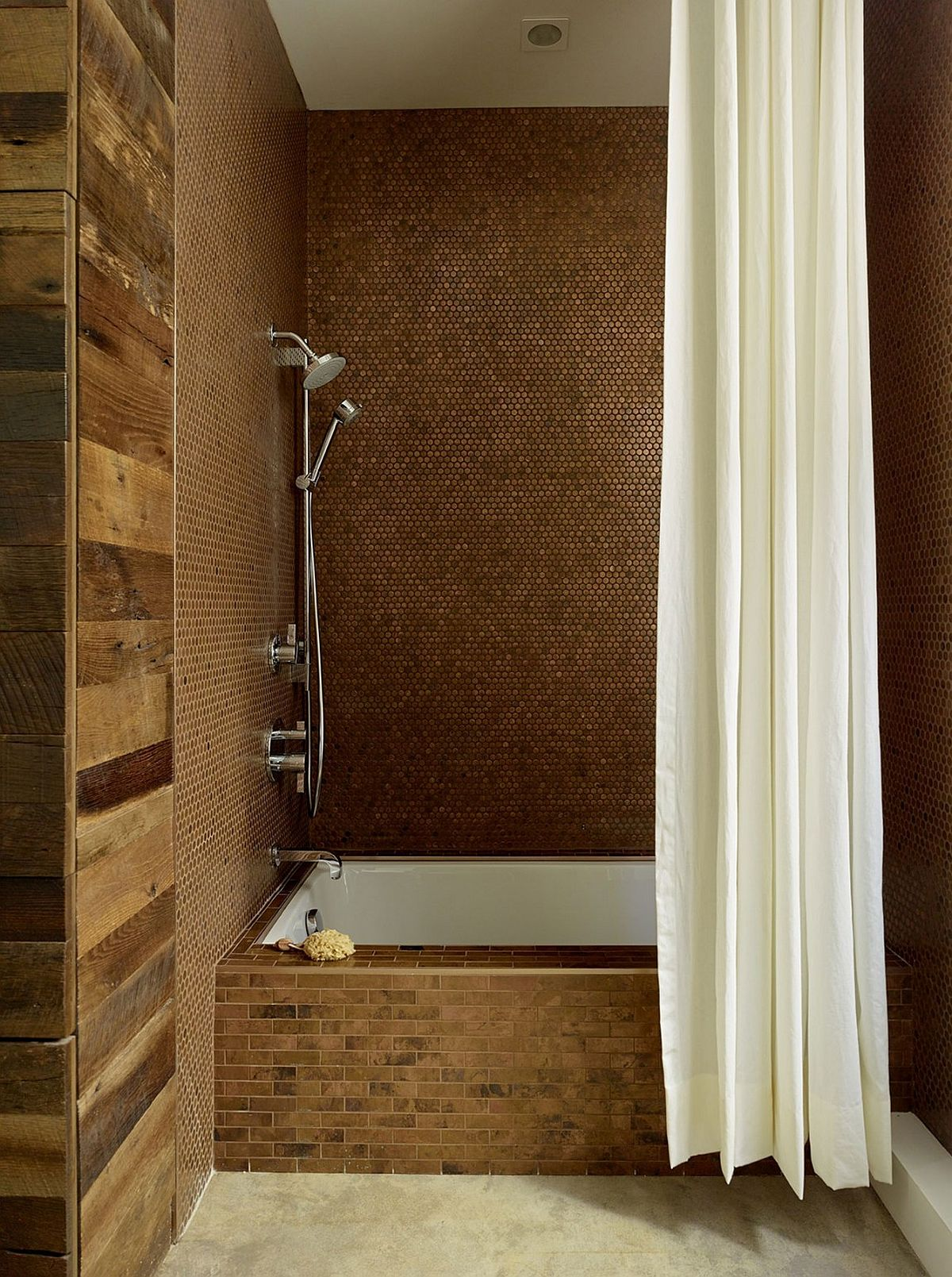 Penny tiles create glittering walls in the shower area