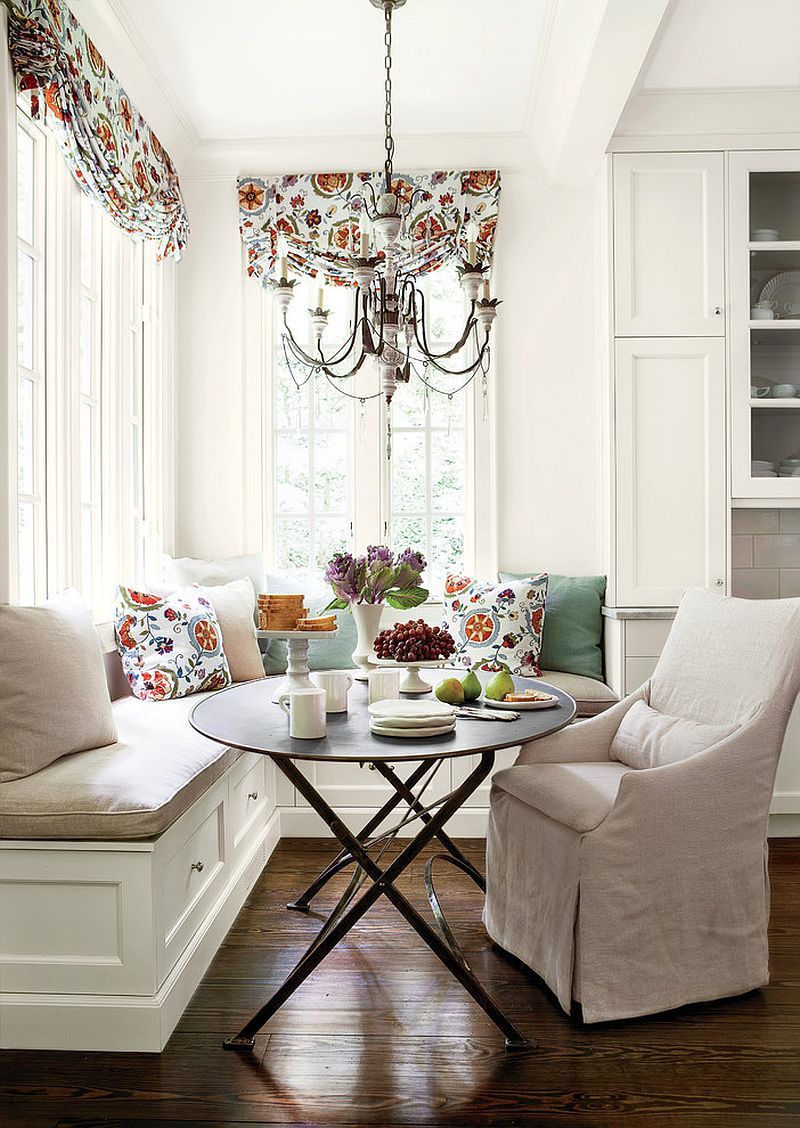 Pillows and drapes add color and freshness to the all white banquette [From: Erica George Dines for Southern Living]