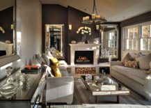 Posh-living-room-of-London-penthouse-with-cozy-fireplace-and-mirrored-decor-217x155