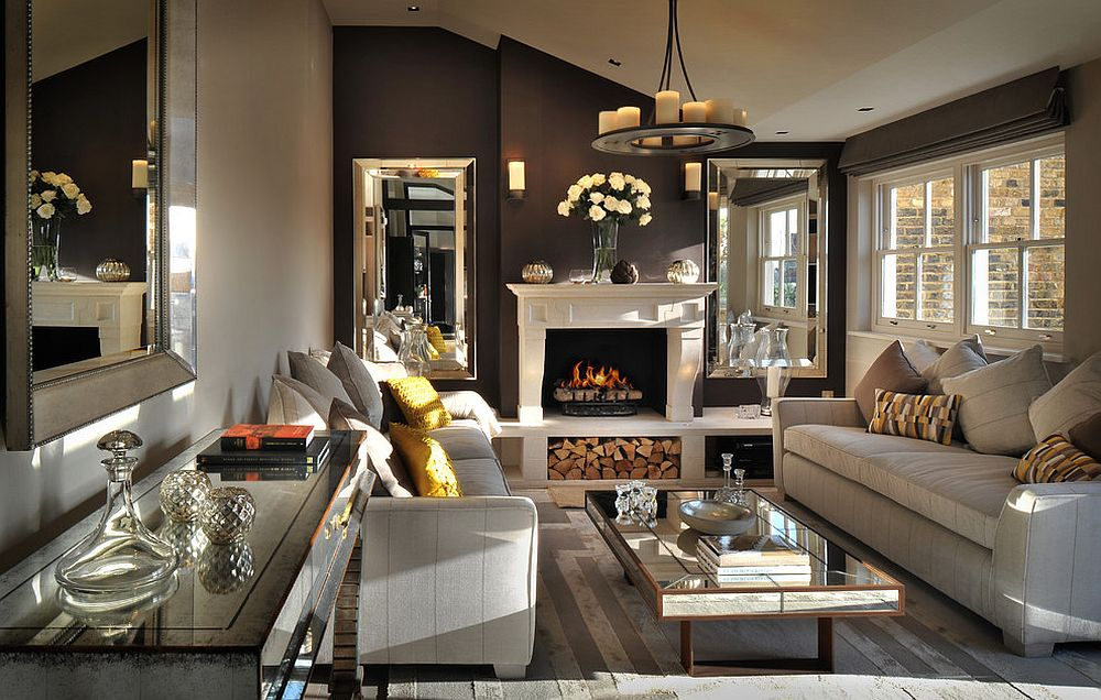 Posh living room of London penthouse with cozy fireplace and mirrored décor [Design: Zephyr Interiors]