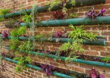 Rain gutter garden with copper vessels 217x155 Think Green: 20 Vertical Garden Ideas