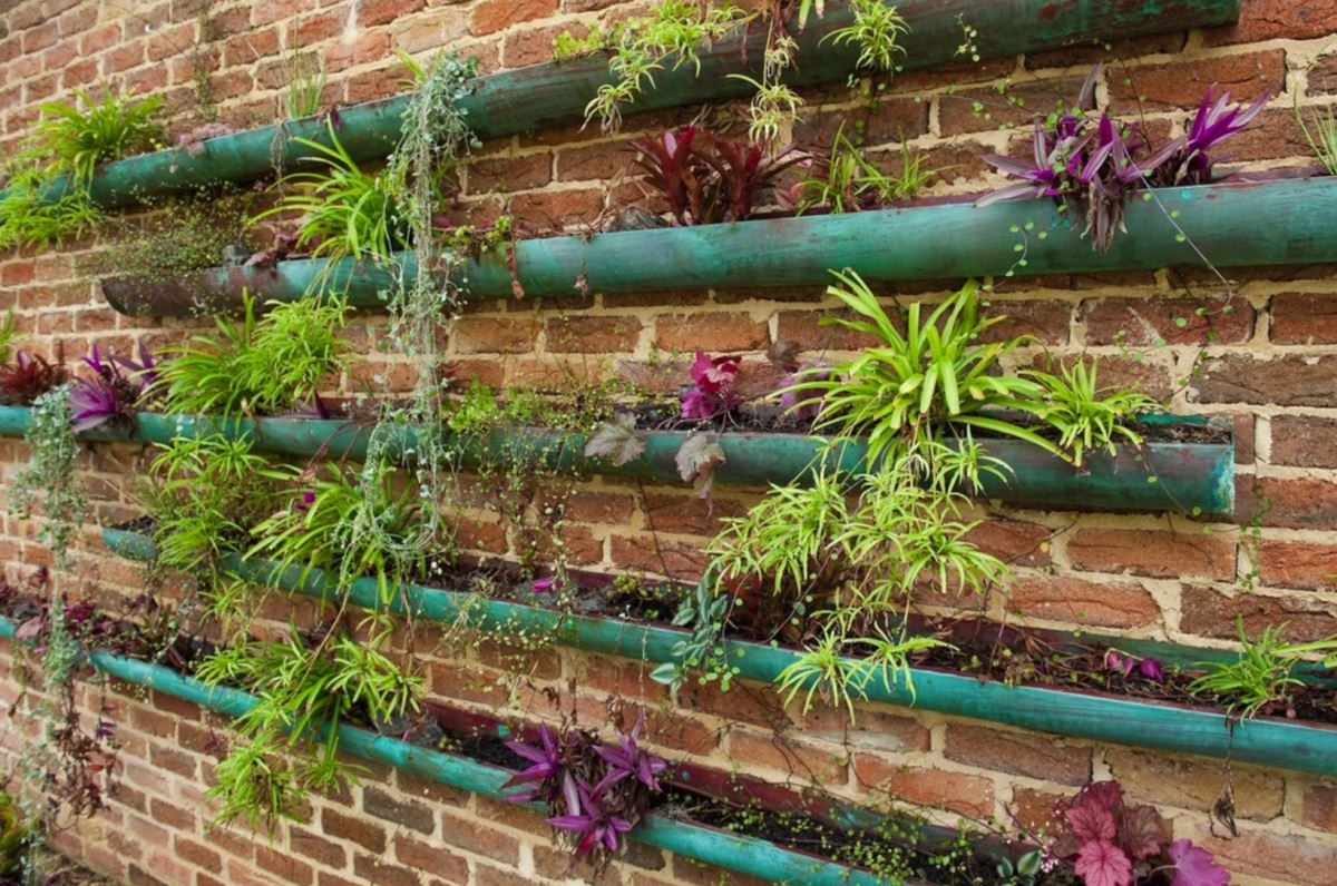 Rain gutter garden with copper vessels
