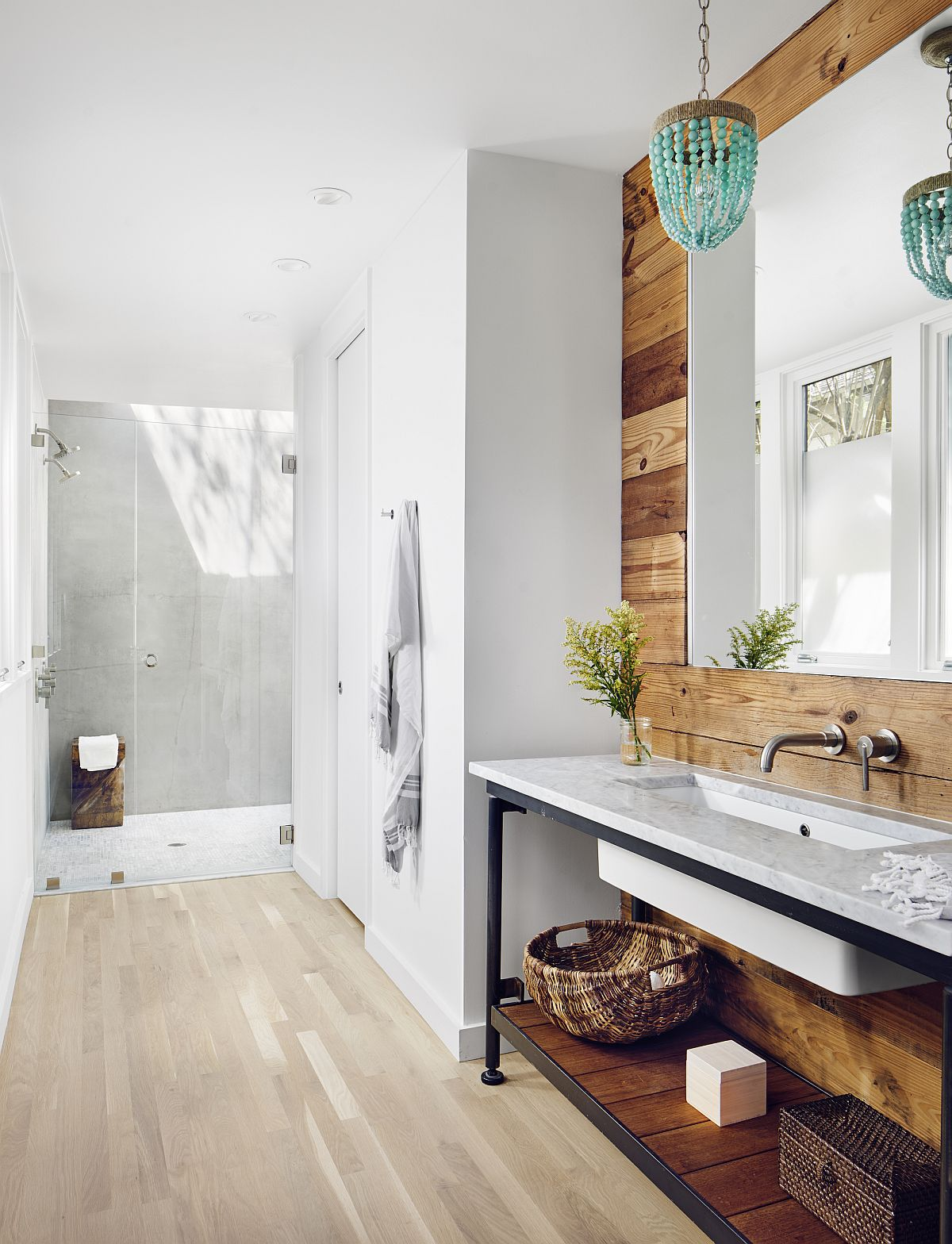 Reclaimed wood adds softness and unique character to the contemporary white bathroom