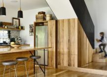 Revamped kitchen design with a fabulous wooden island and tiled backsplash