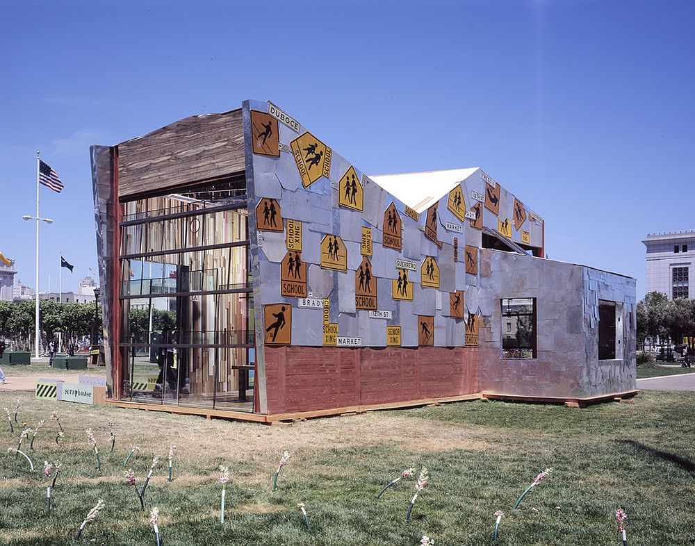 Salvaged and reclaimed school crossing signs cover the exterior of the Scraphouse [Design: Jensen Architects]