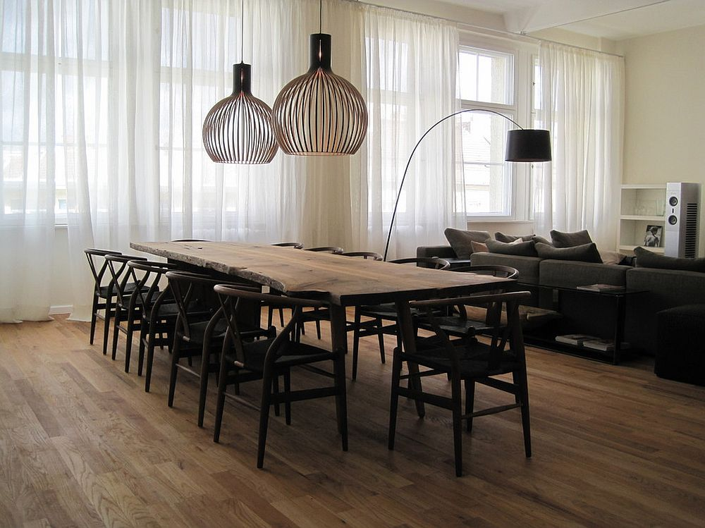 Scandinavian style dining room with a live edge table [Design: Laux Interiors Berlin]