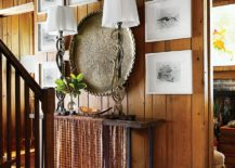 Seabird engravings framed in white coupled with large brass Indian plate create a stunning entry wall