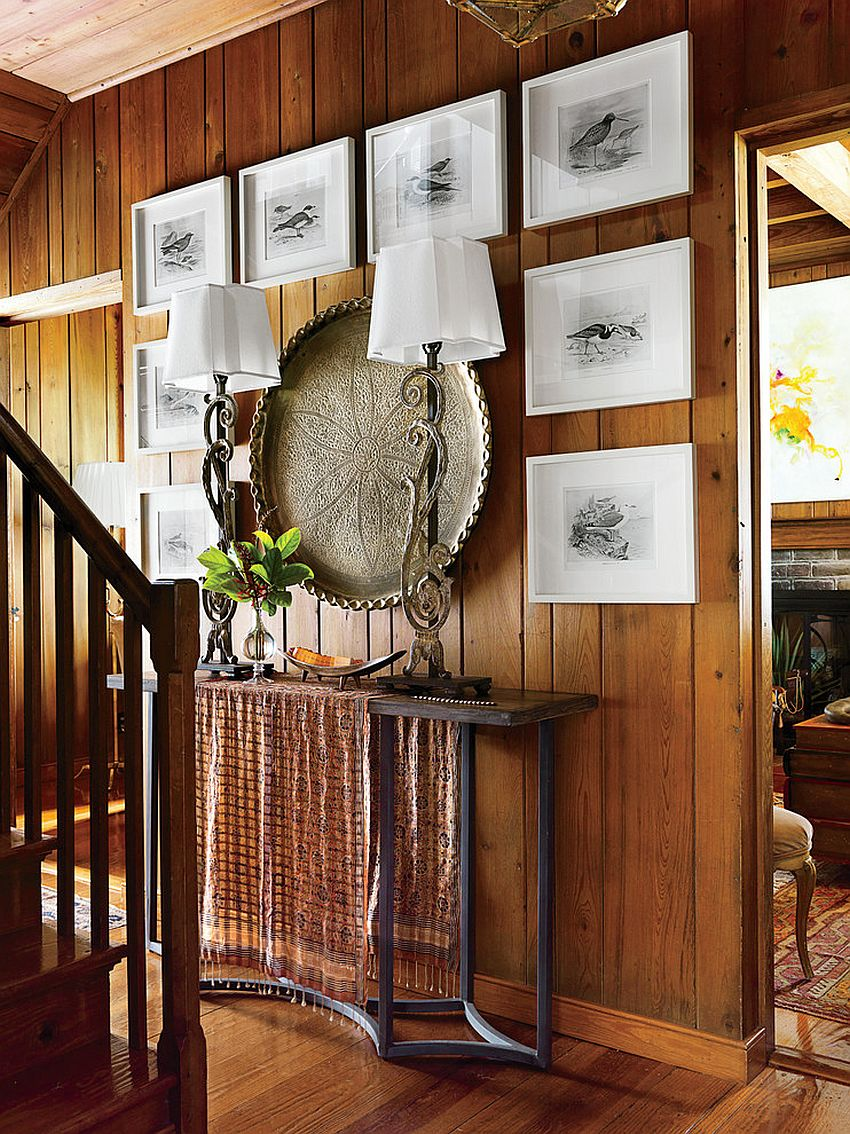 Seabird engravings framed in white coupled with large brass Indian plate create a stunning entry wall [From: Jonny Valiant for Southern Living]