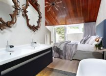 Sensational bronze mirrors above the vanity steal the show in this master bath
