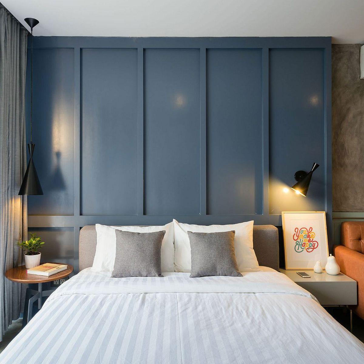 Serene bedroom design with blue backdrop