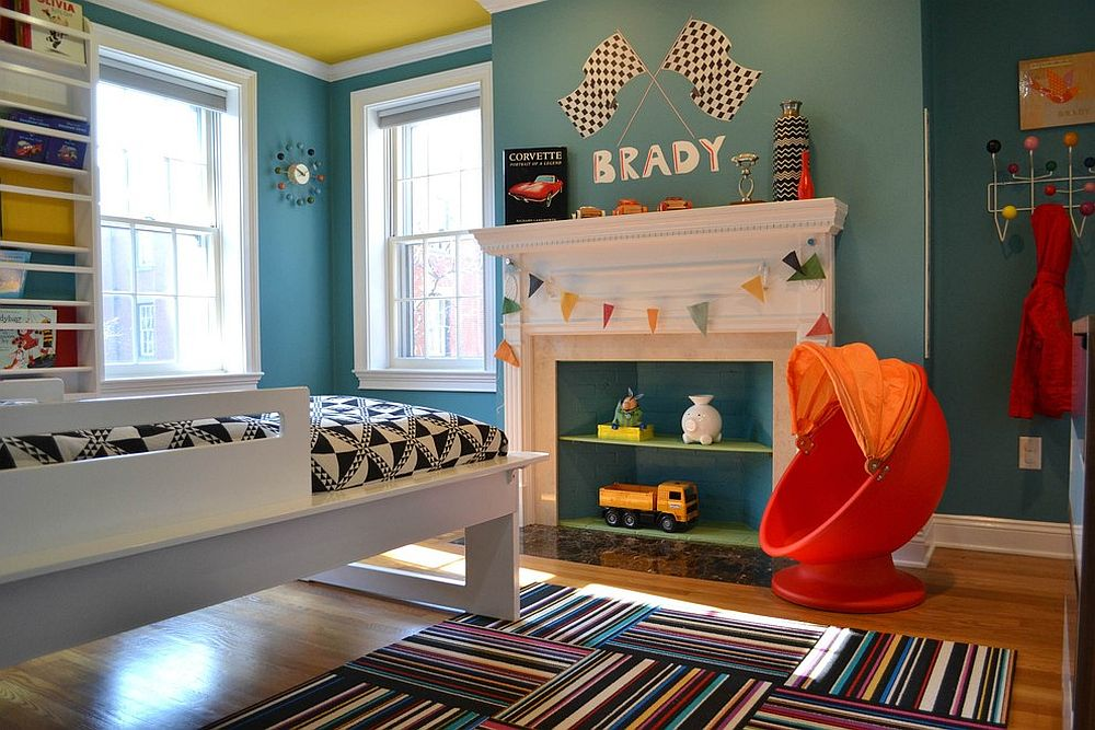 Shades of blue coupled with yellow and red in the chic kids' bedroom [From: colorTHEORY Boston]