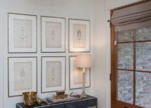 Simple and beautiful entry with a slim desk and gallery wall