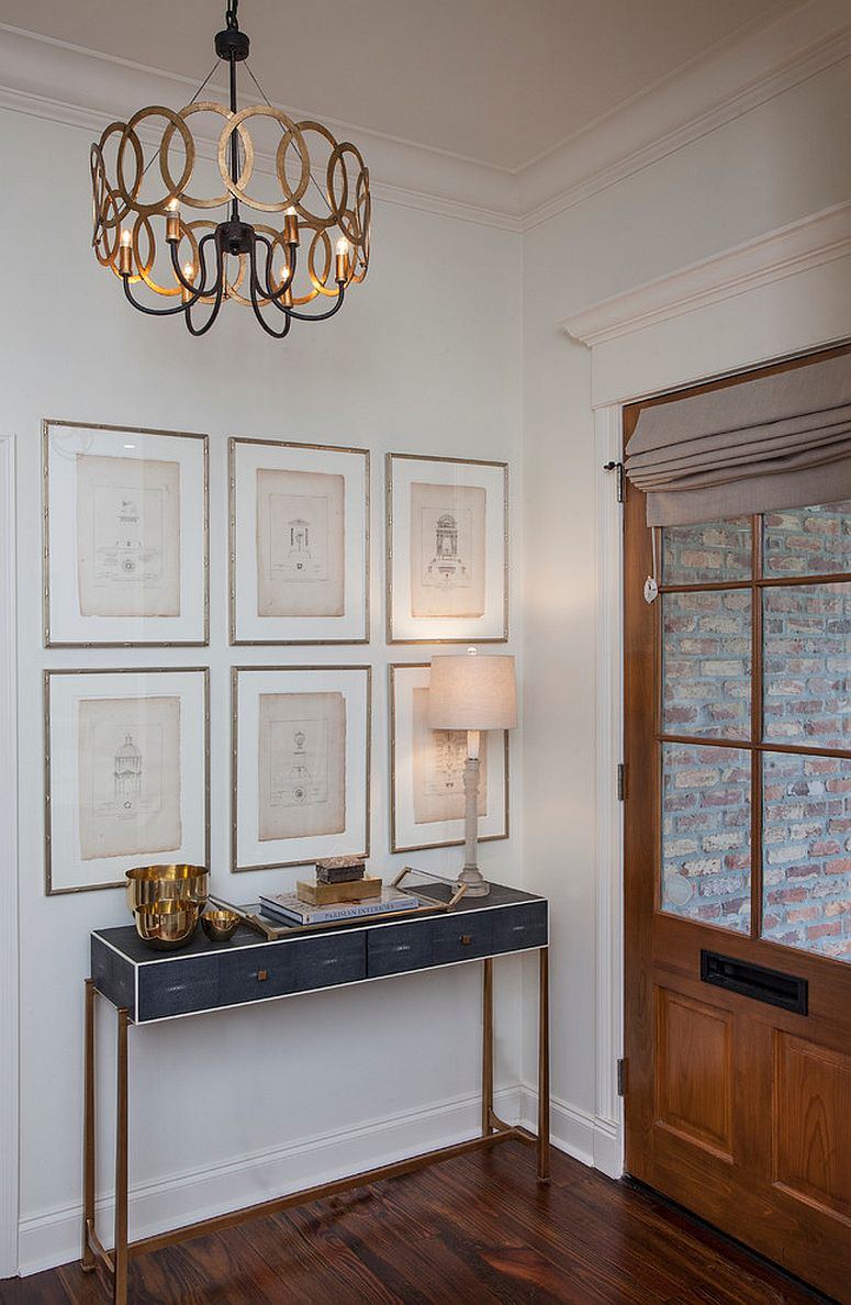 Simple and beautiful entry with a slim desk and gallery wall [From: TY Larkins Interior / Chad Chenier Photography]
