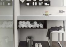 Sleek floating vanity with open storage space for towels